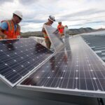 August 19, 2010-NREL workers install PV panels on the roof of the RSF at NREL in Golden, CO. ( Photo by Dennis Schroeder)